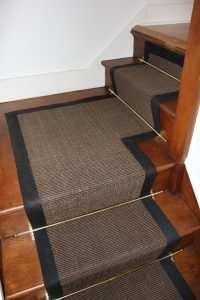 half lnding stairs with stair carpet