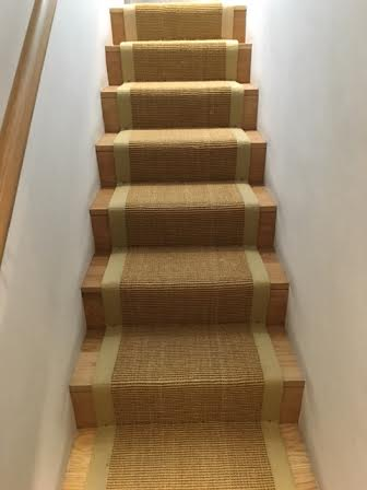 Sisal gold , beige border fitted with gripper to oak staircase