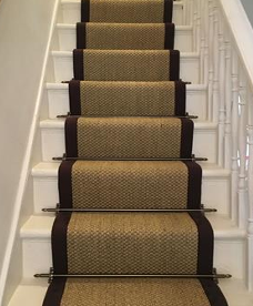 Coir Stair Carpet Fitted To A Straight Staircase With Stair Rods