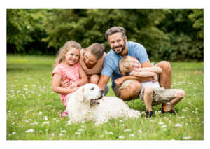 A picture of family with their dog happy being in the nature